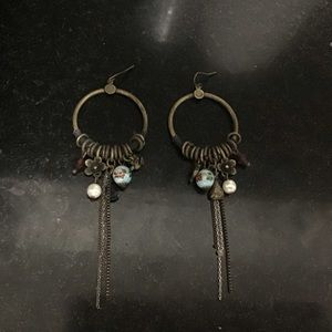 Worn gold small hoops with boho style ornaments